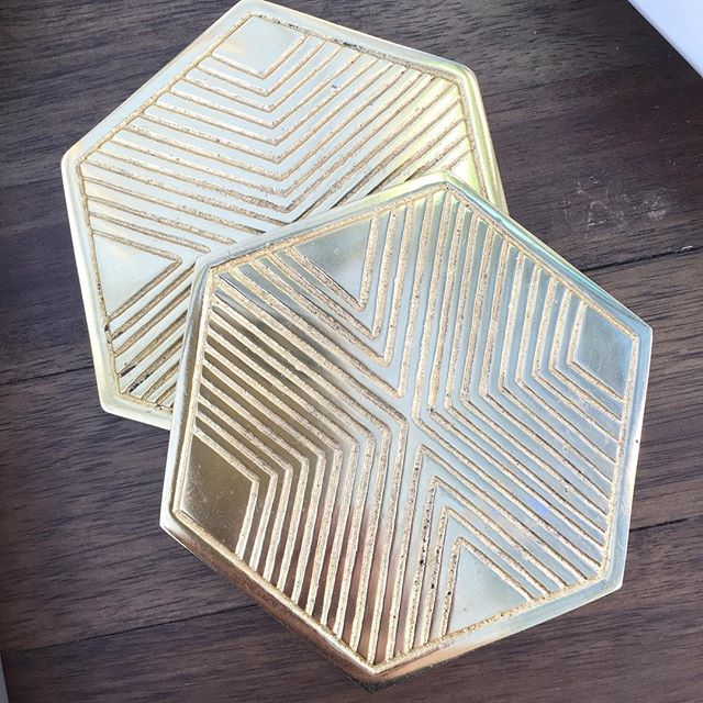 Brass hex coasters in sets of four.  Stop by and see them in person. We're open today from 11-6.