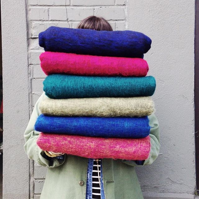 Pretty spring colors piled up high.  Cozy brushed wool blankets perfect for every season.