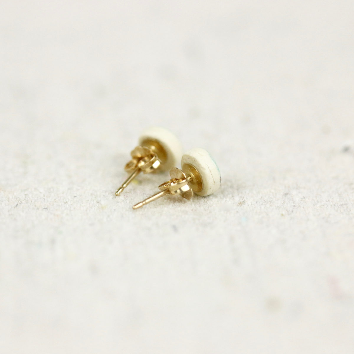 tiny pebble studs back view