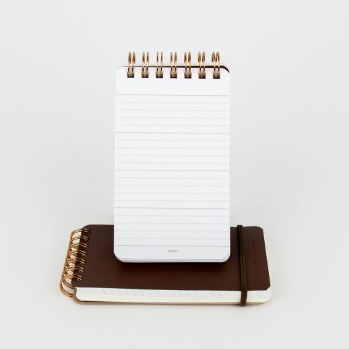 This spiral bound notebook with leather cover and elastic closure