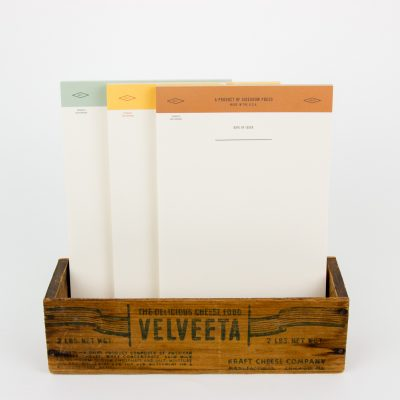 Unlined notepads with border in green, yellow or tan